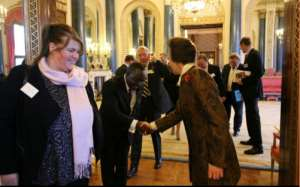 HRH Princess Anne welcoming Ivan Quashigah, a trustee of the St. Nicholas Foundation to the launch at Buckingham Palace