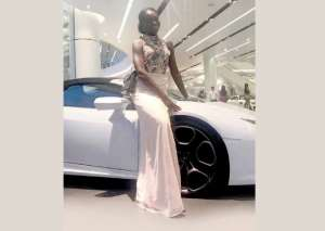 Afua Asieduwaa Akrofi standing by the fast car