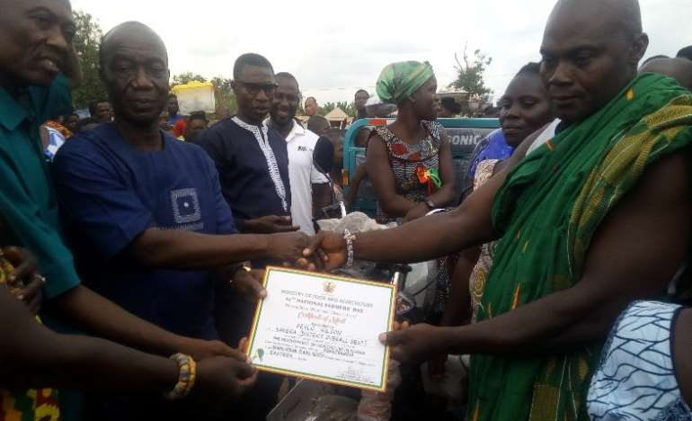 Mr Fevlo(in cloth) receiving his certificate