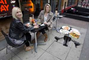 A drone brings food to customers at YO! Sushi Restaurant in London- Photo credit: Neil Hall / Reuters