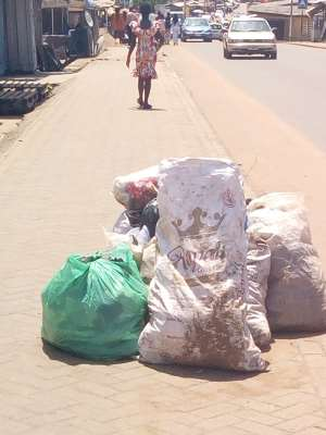 Photo by Pamela - Refuse disposed at Odorkor-Official Town on pavement