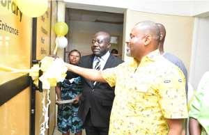 Robert Kuzoe and Prof John Frank Eshun cutting the tape to open the e-library