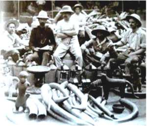 Members of the nefarious British Punitive Expedition of 1897 posing proudly with looted Benin artefacts.