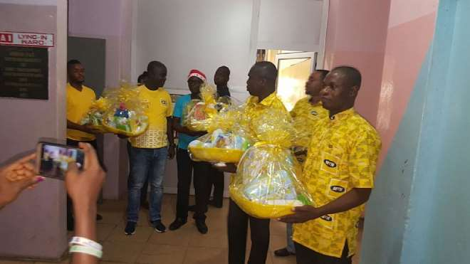 Staff Volunteers Carring Hampers To Be Presented To Mothers And Their Ba...