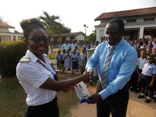 Audrey is seen here receiving the Citation from Mr. Alfred Codjoe Allotey, Head of the University Basic School