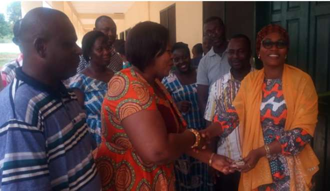 Hon. Evelyn Ama Kumi-Richardson MCE For Sunyani Handing Over The New Classroom Block To Vice Principal Of The Sunyani Nursing And Midwifery Training School, Madam Aisha Sena-Iddrisu