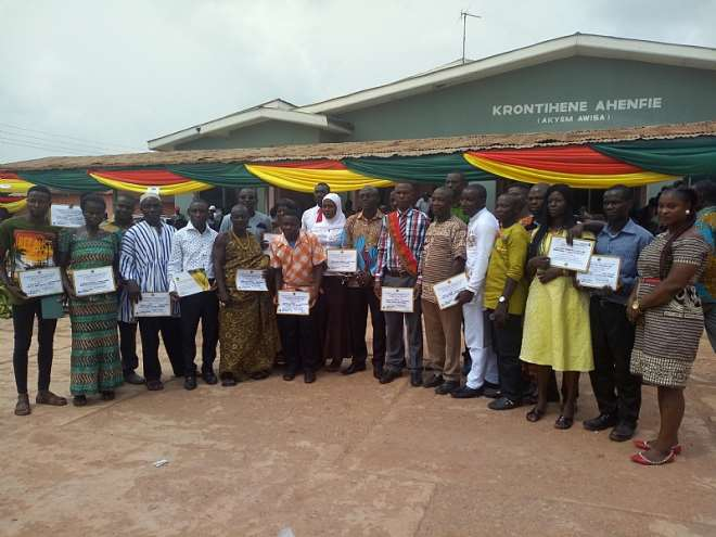 The Awardees flanked by the DCE and Omanhene