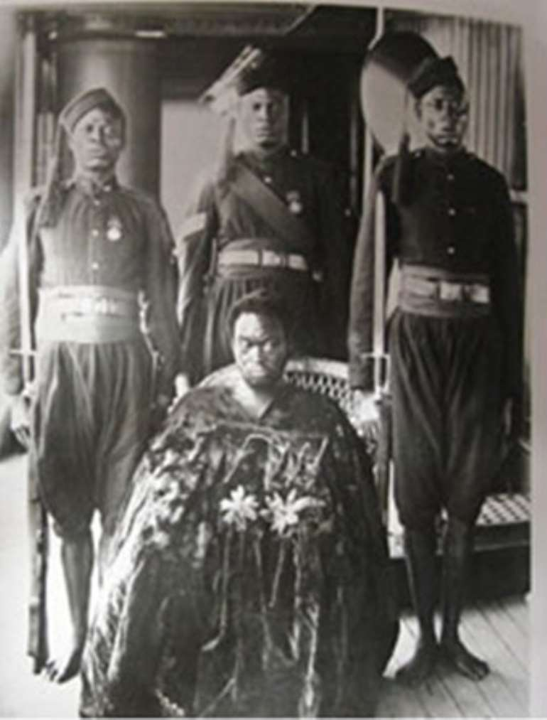 Oba Ovonramwen, from whose palace the British looted the Benin Bronzes in 1897, with foot chains, guarded by soldiers on board a British ship to exile.