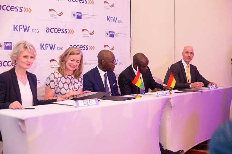 212201942907_0f72ym3xxs_mr_olatunji_md_for_access_bank_ghana_cosigns_mou.jpeg