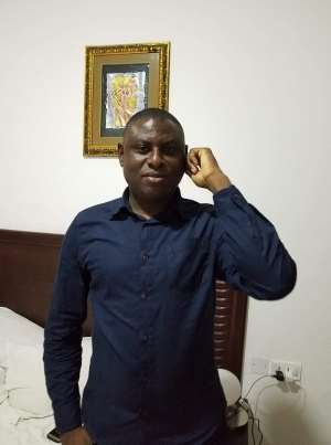 Hon Gilbert Ken Asmah