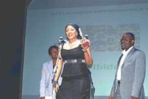 Actress Bisi Ibidapo-Obe with her award