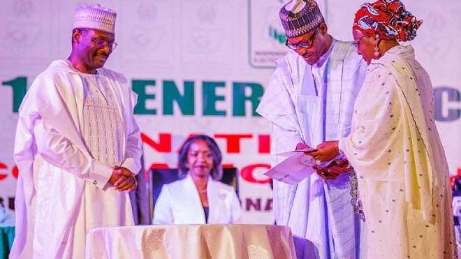Nigeria's President Buhari receives his certificate of election from INEC chairman Mahmood Yakubu