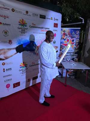 Mr Herbert Mensah, President of Ghana Rugby and Ghana Olympic Committee (GOC) Board Members, holding the Gold Coast 2018 Queen's Baton at gala dinner in Accra on Sunday 19 March 2017.