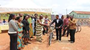 Chief of Trede in the Ashanti Bekwai Municipal presenting the bamboo bike to one of the Farmers