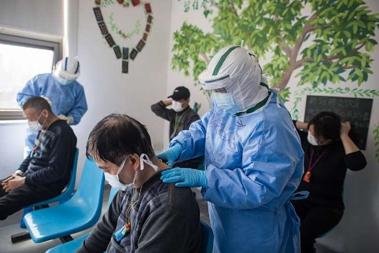 Medical workers massage patients' acupuncture points at the Wuhan pulmonary hospital in Wuhan. Photo: Xinhua