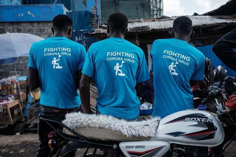 Staff members of Local NGO Shining Hope for Communities (SHOFCO) in the Kibera slum, Nairobi, on March 20, 2020. - Source: Photo by YASUYOSHI CHIBA/AFP via Getty Images