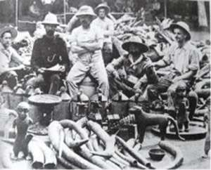 Members of the notorious British Punitive Expedition displaying proudly their loot.