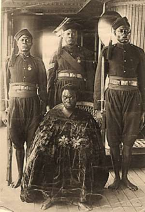 Oba Ovonramwen, during whose reign the British looted the Benin Bronzes, with guards on board ship on his way to exile in Calabar in 1897 .His overflowing gown covers the shackles the king is wearing on his feet.