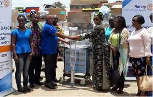 Hajia Nana Fatima High (right) handing over the medical equipment to Dr. Mensah Manye, Medical Superintendent Ejura Government Hospital