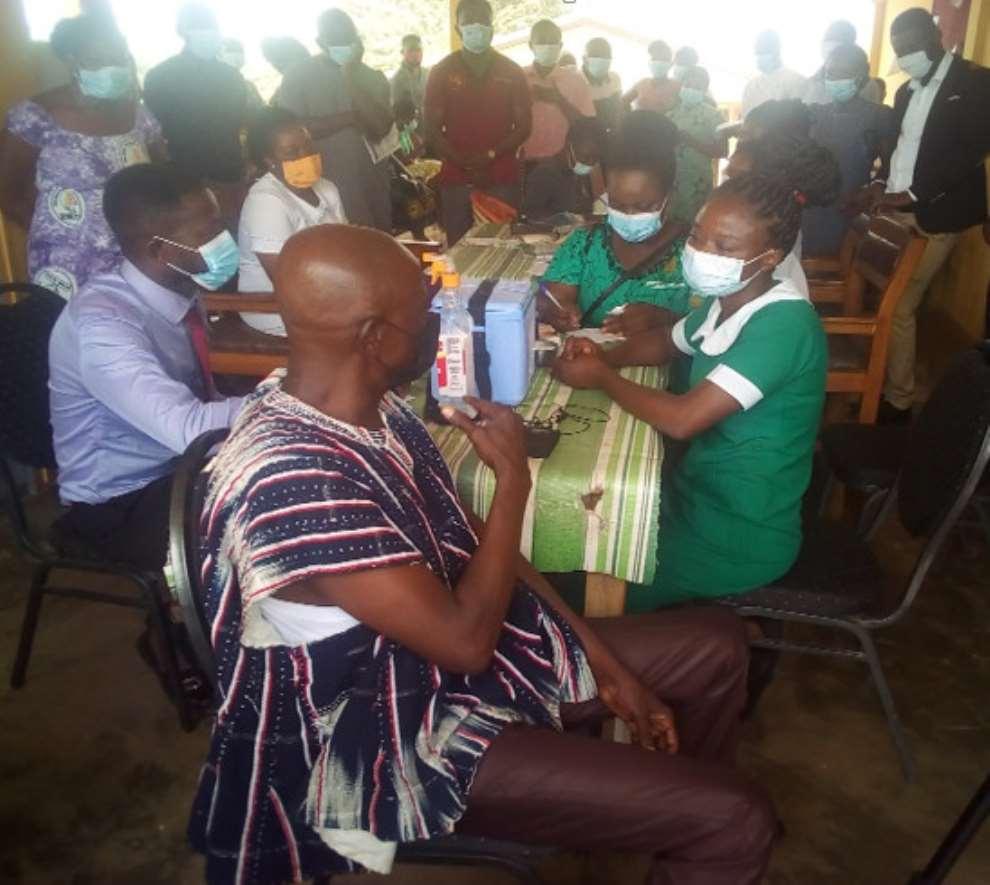 MCE for Berekum, Mr. Kofi Adjei taking the COVID-19 jab