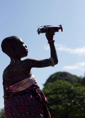 A woman holds a drone in Anyako, Ghana Photo By Seth Ebenezer Tetteh via UnSplash