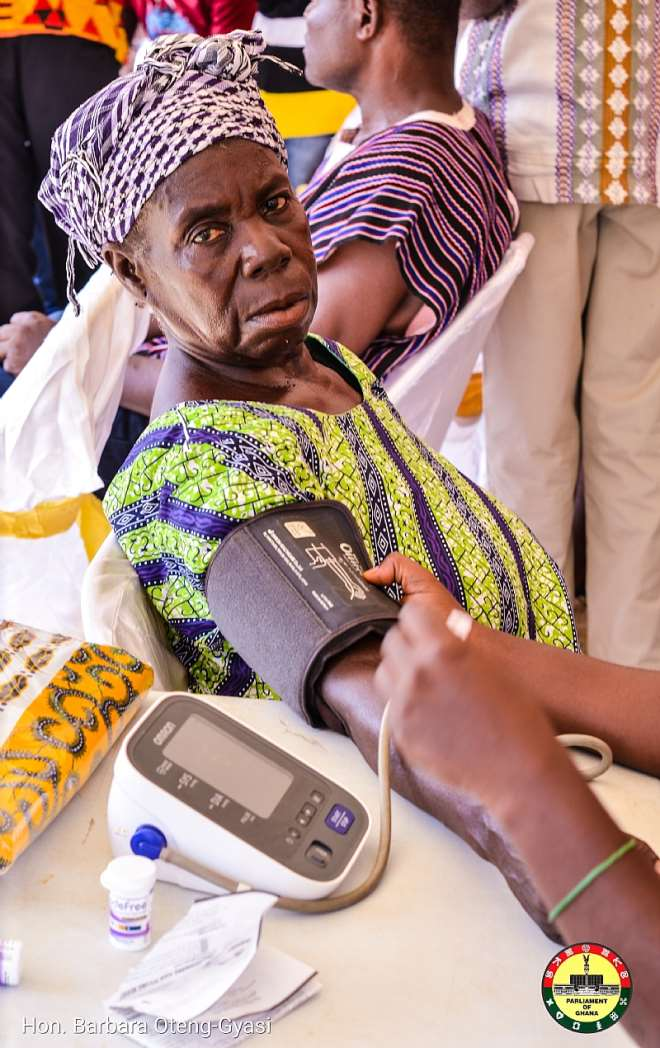 A Widow having her BP checked