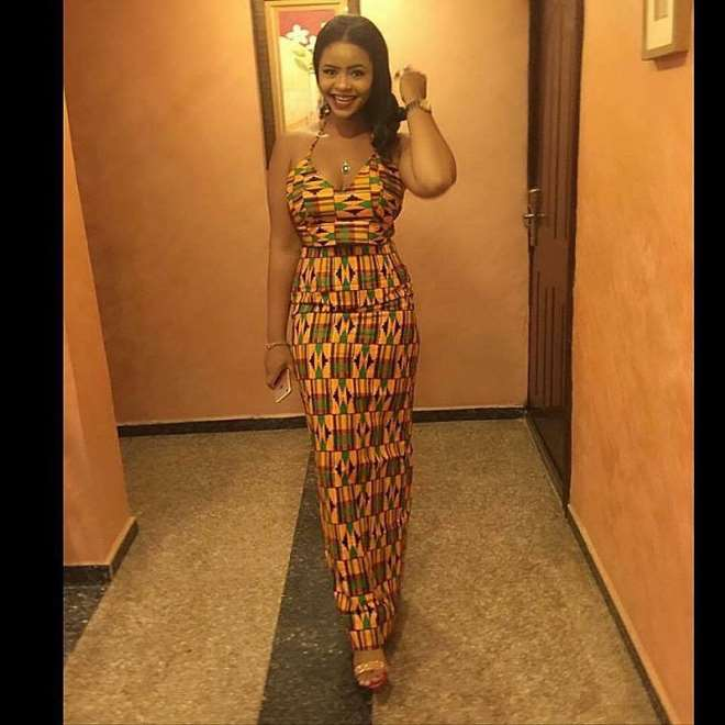 Africa lady wearing kente