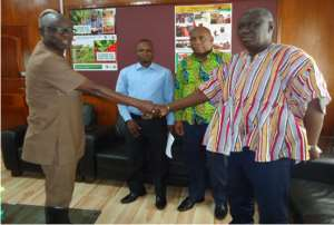 Mr. Asomah-Cheremeh, Reg. minister exchanging greetings with Chief Director, Mr. Oppong Kwame after the inauguration
