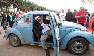 José Mujica in his Volkswagen Beetle. Photo credit: Natacha Pisarenko/AP