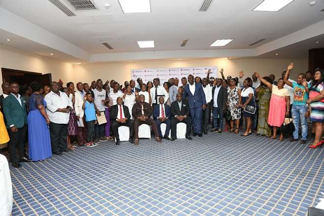 Some Executives Of Capital Bank In A Group Picture With Participants
