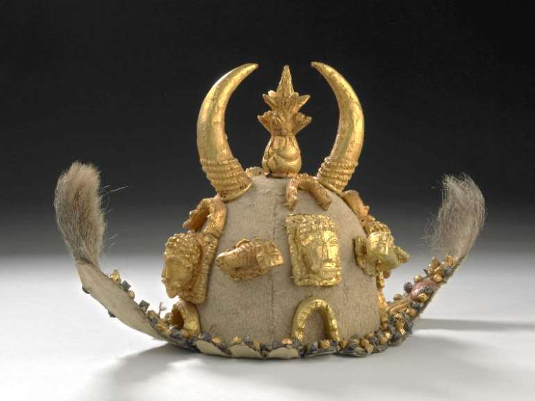 Ceremonial hat, head-dress made of shells, gold, skin (deer), silver. Asante, Ghana, now in the British Museum, London, United Kingdom.