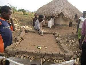 Africans are naturally healthy and happy people: A locally made clay pool board in a village.