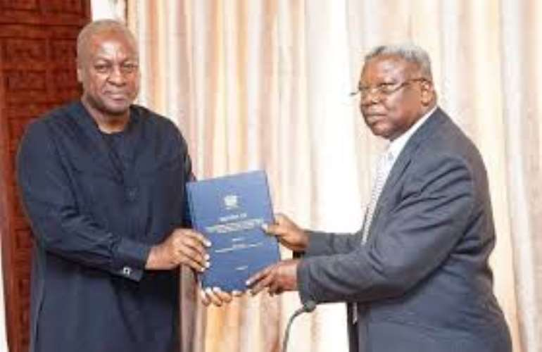 Photo: President John Mahama receiving the report of the Sole Commissioner Justice Yaw Apau