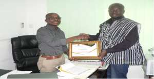 Business Development Manager of Alliance Waste, Mr. Seth Maclean Acquah, (L), receiving a certificate of honour from the Communications Director of HMI, Mr. Abdallah Musah (R).