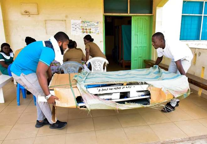 Prince Amarh (in White) And Another Youth Of Tema Conveying The Strecther To The Polyclinic