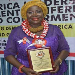 Hajia Damata Sulemana displays her award