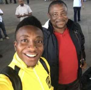 Goalkeeper Annan (L) with coach Paa Kwesi Fabin at the Airport