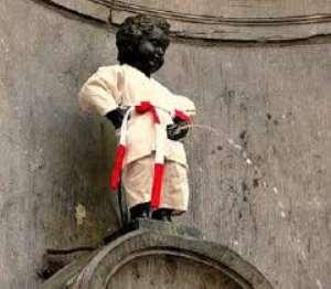 Little boy Manneken in judo outfit urinating in Brussels