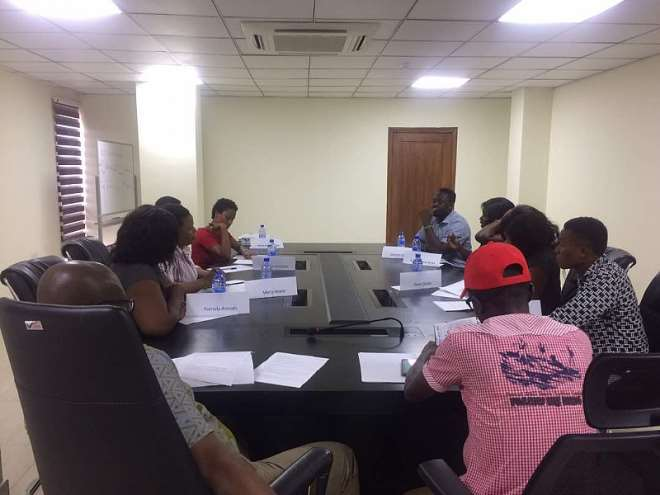 9142017125128 the eight selected applicants taking a group assessment test