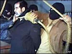In a last act of defiance Saddam Hussein refused to wear a hood