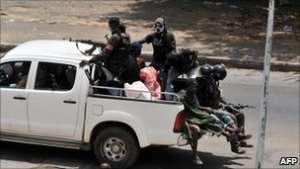Militiamen loyal to Laurent Gbagbo have been patrolling Abidjan and setting up roadblocks