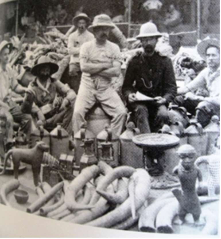 Members of the infamous Punitive Expedition of 1897 proudly posing with looted Benin artefacts.