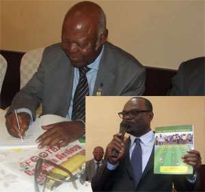 Ben Koufie signing a copy of the book INSET: Dr Amoah displaying a copy of the book.