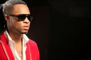 Singer, Flavour Saves Fans from Fraudsters