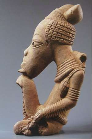Seated person. Nok cultural object, 500 BC - 500 AD. Quai Branly, depot of Louvre, inv.No.70.1998.11. One of the three stolen items from Nigeria now in Paris.