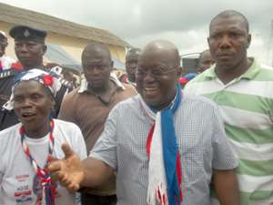 Nana Addo responmding to cheers on arrival in the region