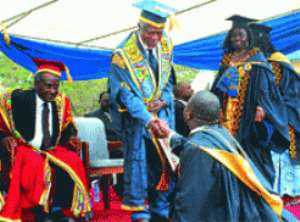 Mr Kofi Annan (3rd left) Chancellor of the University congratulating one of the graduates at the congregation in Accra.