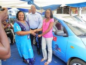 Mrs. Leo-Mensah Receiving The Keys To Her Brand New Hyundai i10 From Ms. Tracy Kyei As Mr. Leo-Mensah Looks On