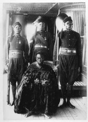Photograph by the Ibani Ijo photographer J A Green. Oba Ovonramwen with guards on board ship on his way to exile in Calabar in 1897.
