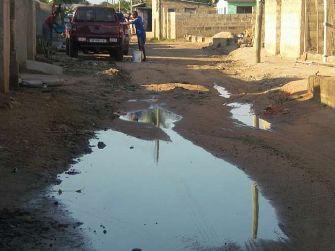 poor road with stagnant water